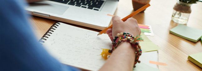 Students reviewing academic writing for university study