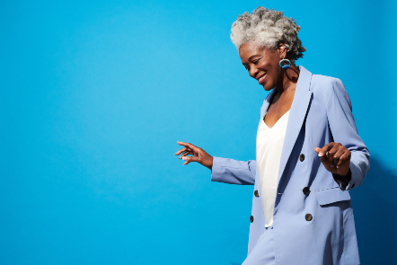 Woman in a suit on a blue background