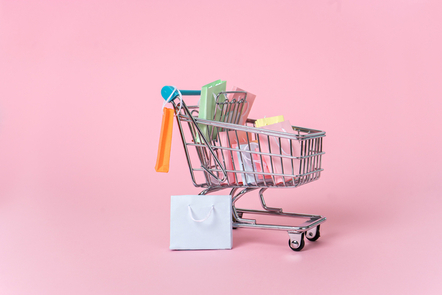 A small shopping trolley filled with gifts