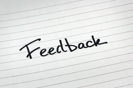 A page with the word 'Feedback' written down.