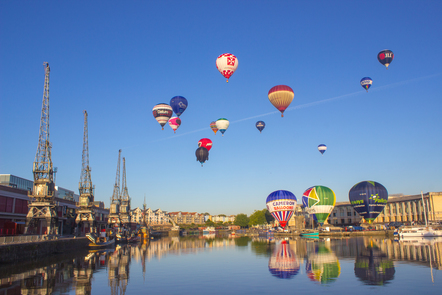Hot air balloons flying over the river Avon
