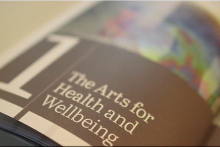 "Photograph of the inside of the Creative Health report, showing the words ""The Arts for Health and Wellbeing"""