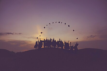 Students throw hats in the air