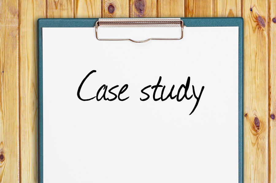 A clipboard with the words Case Study written on it, on a wooden background.
