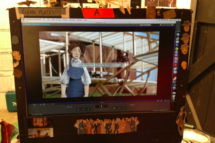 image of female character in front of her plane on monitor screen