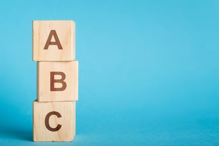 ABC letters on wooden blocks stacked in pillar