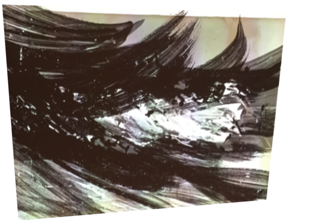 This is an abstract image, mostly black and white, it looks a little like waves and see spray