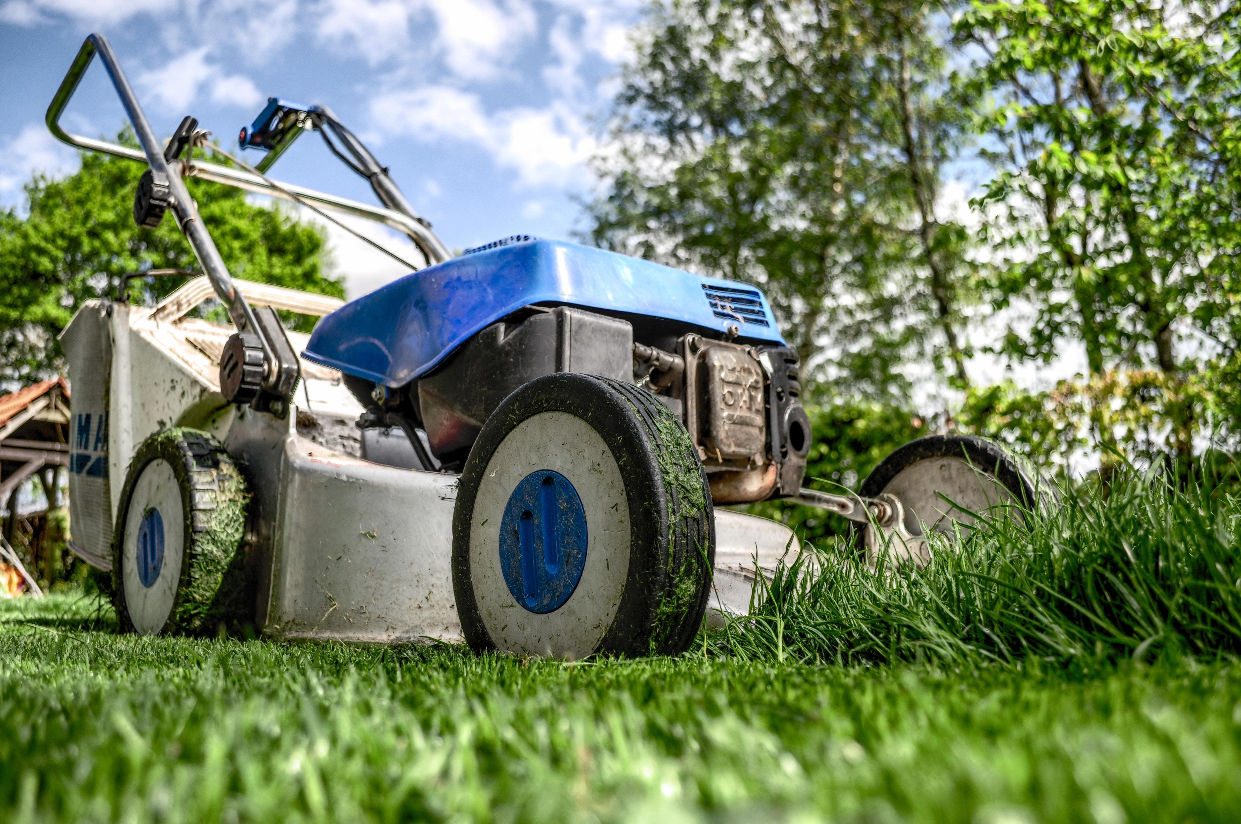 lawnmower mowing grass