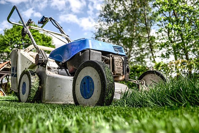 lawnmower mowing grass