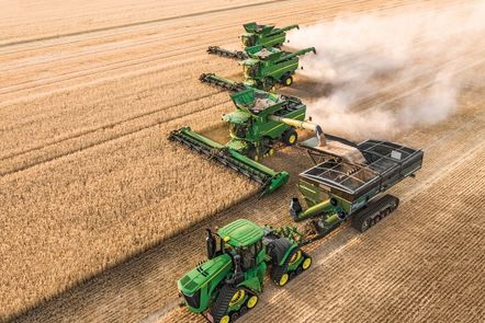 Combine harvesters on a field