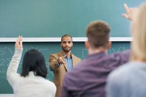 Teacher in front of class teaching mathematics