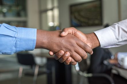 """two people shaking hands"" image by Cytonn Photography on Unsplash https://unsplash.com/photos/n95VMLxqM2I"