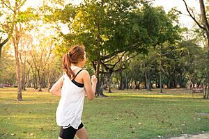 Woman running in the outdoors.