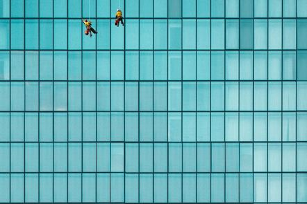 Window cleaners on sky scraper