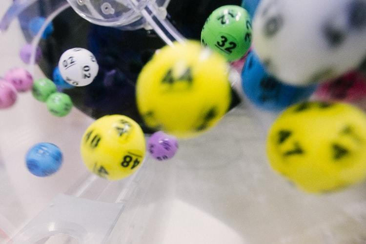 lotto balls fall from their tombola