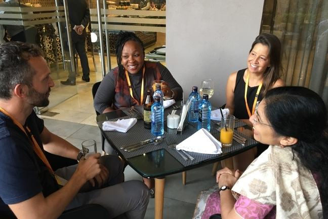 Group of learners relaxing in a cafe
