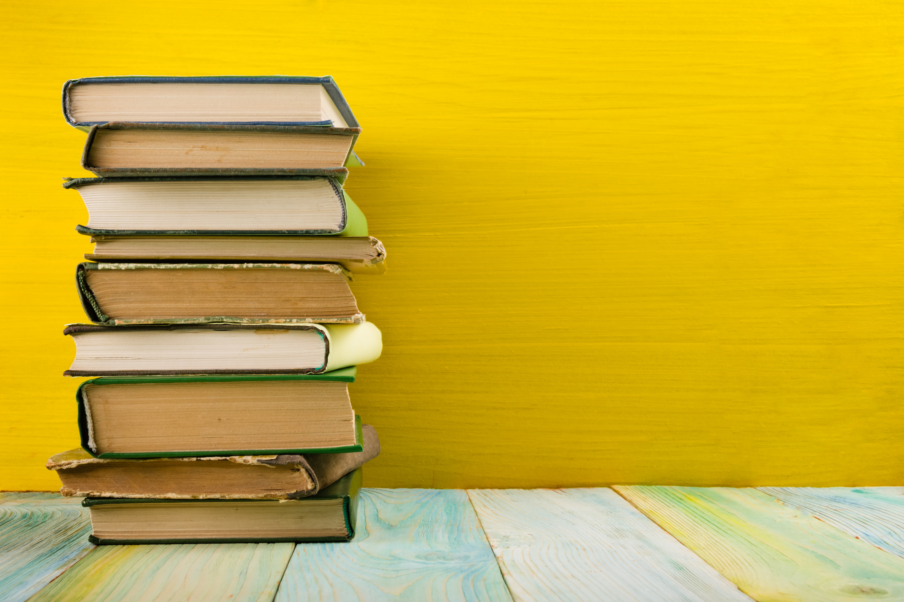 Stack of books, yellow background