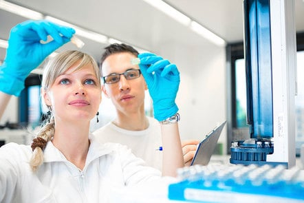 Male and female working in a laboratory