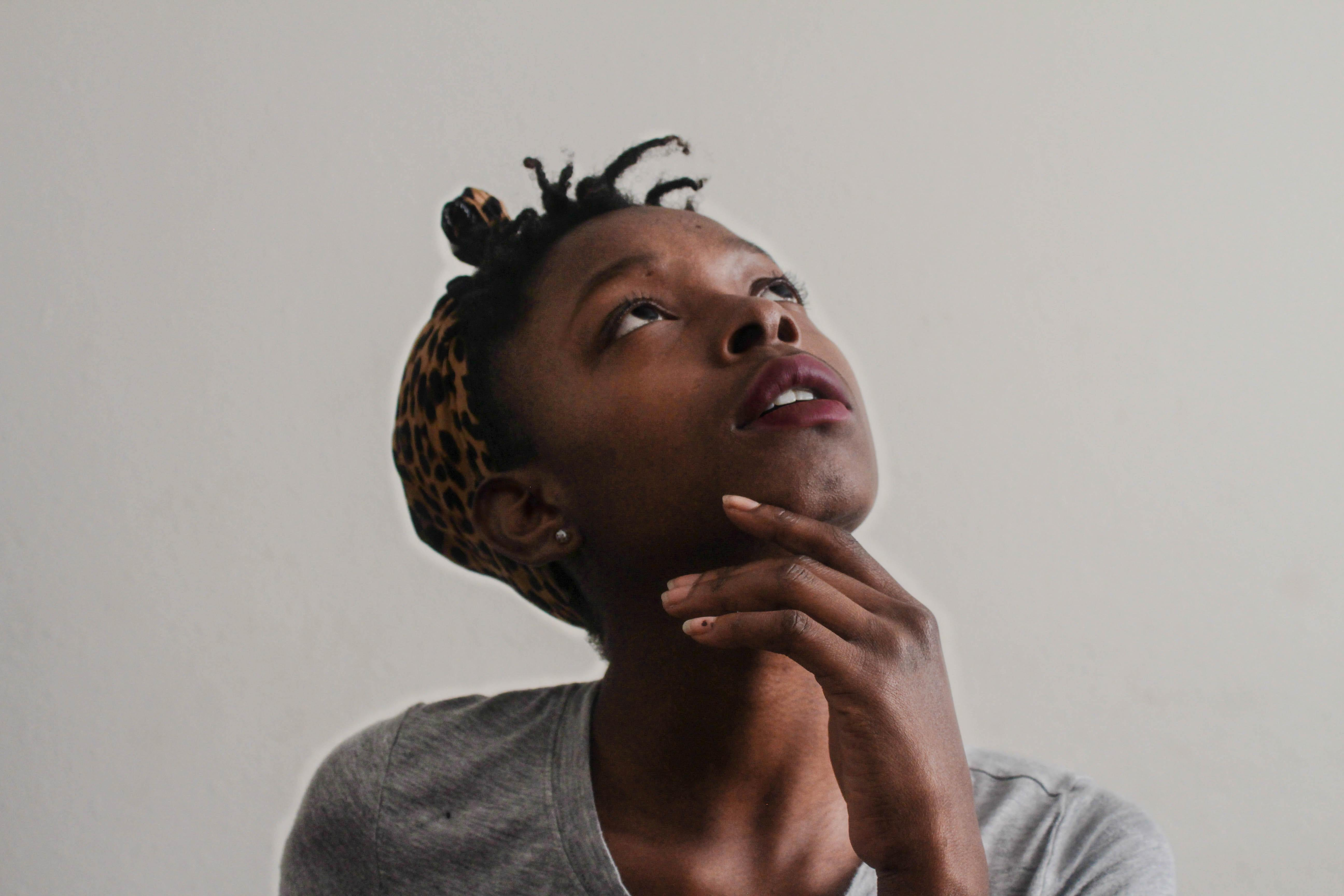 A young woman thinking and looking skyward