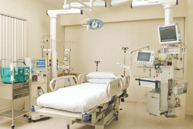 empty ICU bed with machines around it
