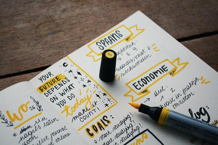 A notebook showing written ideas for the future in different languages
