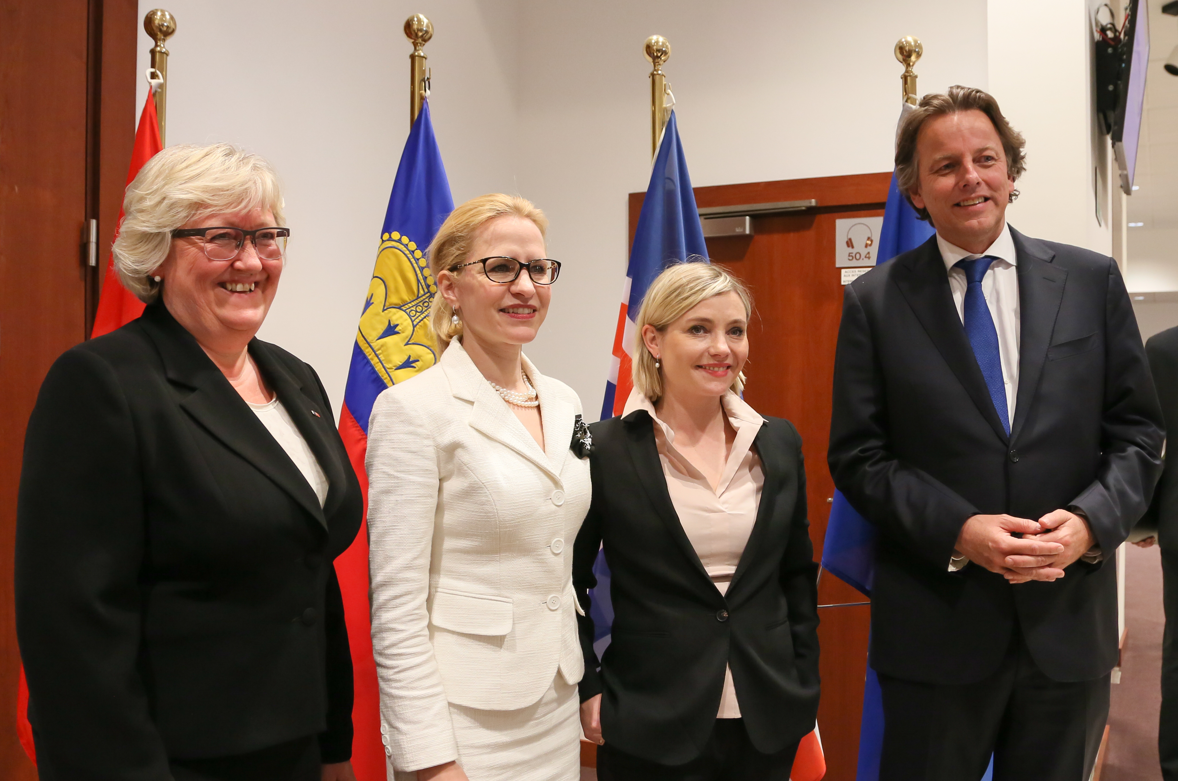 Foreign Ministers of Norway, Liechtenstein, Iceland and the Netherlands standing behind flags for an EEA Council meeting