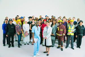A group photograph of people representing a wide range of jobs in the public sphere.
