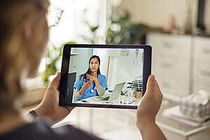 Patient attending remote consultation