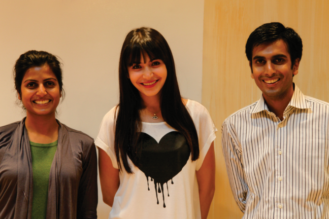 Anushka Sharma with two Jaipur Rugs staff members