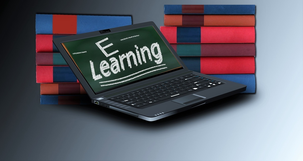 Image of books and laptop