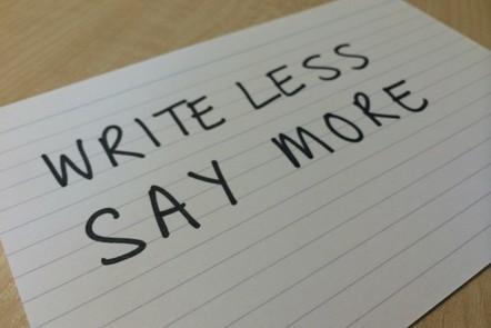 a card with 'write less, say more' written on it