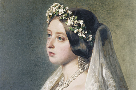 A close up portrait of Queen Victoria in her wedding dress with a garland of flowers and a white veil adorning her hair.