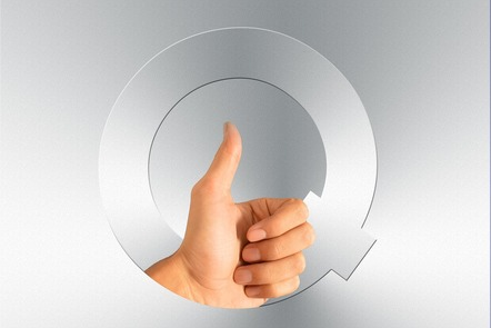 A hand giving a thumbs up sign over the letter Q