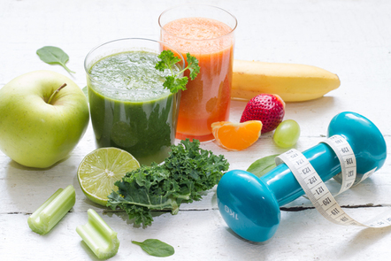 Fruits, vegetables, juice, smoothie and dumb bell.
