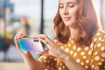 Girl taking a photo with Samsung phone