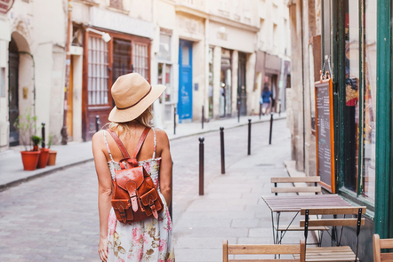 Woman tourist on the street traveling in Europe.