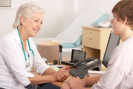 Female GP talking to a young male patient (image: ©Shutterstock)
