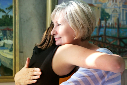 Two females hugging