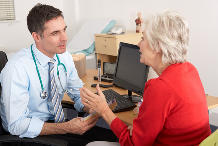 Male GP talking to a female patient (image: ©Shutterstock)