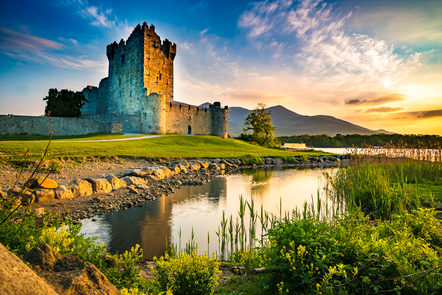 A castle at the foot of a lake in Ireland.