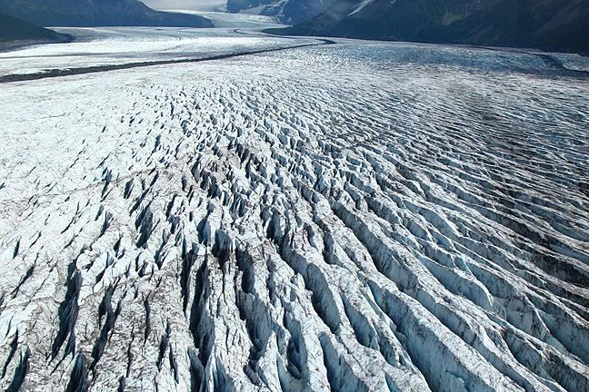 View looking along the surface of a heavily crevassed glacier