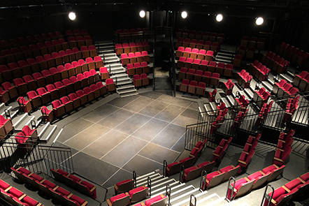 the inside of the auditorium at the Octagon Theatre with the stage in in the round configuration