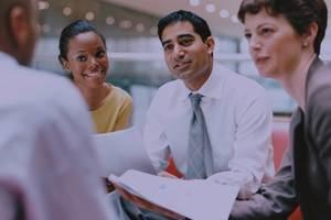A group of business professionals communicating effectively