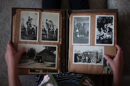 A photo album filled with black and white pictures