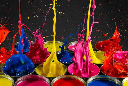 Multicoloured paint splashing from paint pots