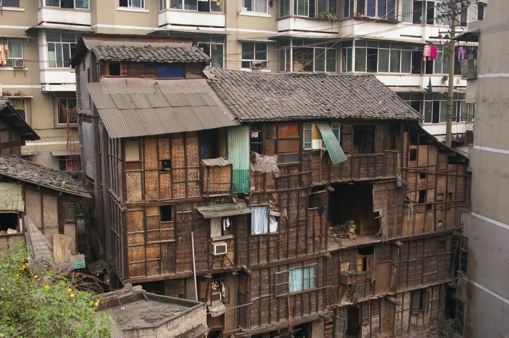 Shibati in Yuzhong District (Chongqing) is one of the many slums in China. The slum is surrounded by recent constructed high rise residential buildings. Chinese government has demolished and cleared numerous slums like Shibati.