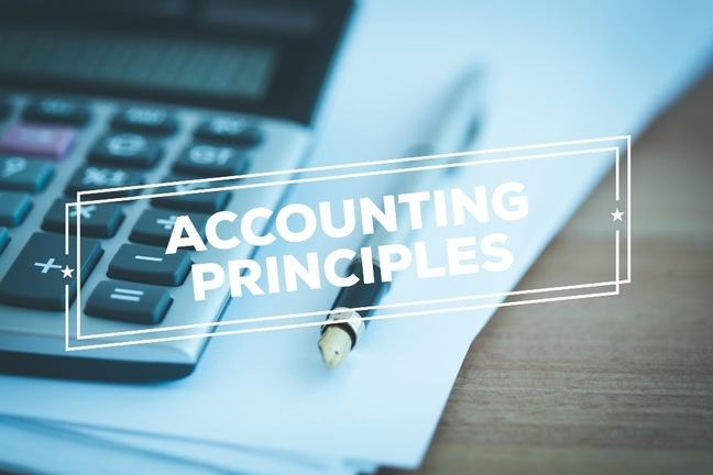 "The title ""accounting principles"" showed on a background with paper and a calculator"