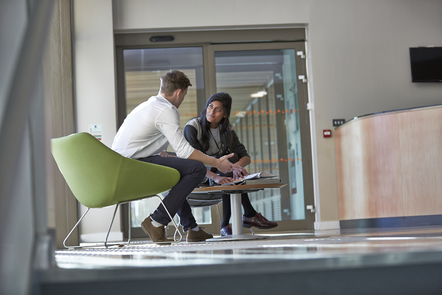 Man and woman talking in a reception area