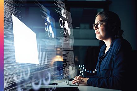 Woman assessing data presented on futuristic screen.