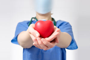 Person holding a toy heart